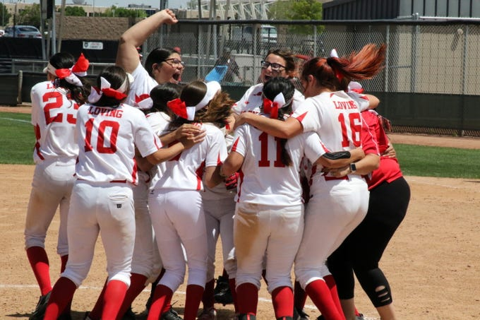 The Loving Lady Falcons celebrate after beating Eunice, 16-4 to claim the school's 17th state championship in softball, the most in New Mexico high school history.