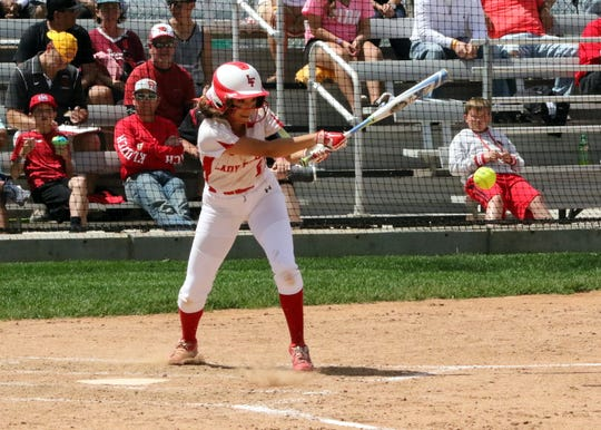 Anyssa Rodriguez hits a ground ball against Eunice on Friday. Loving won, 16-4 to claim its 17th state title in softball.