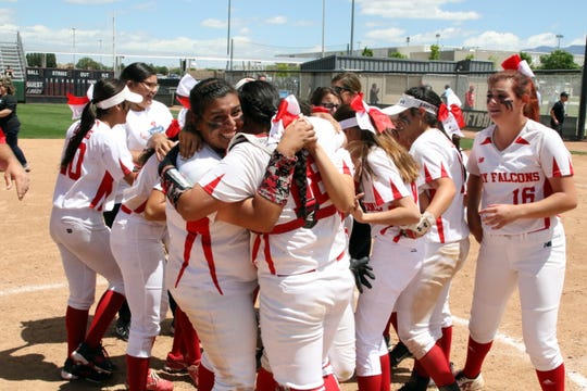 Lorisa Martinez, left, hugs catcher Andrica Gomez after Friday's morning game against Eunice for the Class 2A state title. Loving beat Eunice, 16-4 to claim the school's 17th state championship in softball, the most in New Mexico high school history.