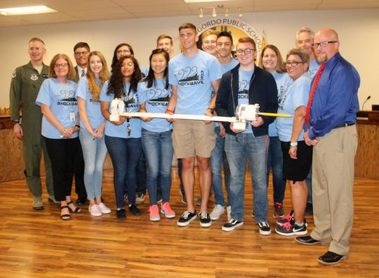 The Alamogordo High School Shockwave Physics team and representatives from the Holloman High Speed Test Track with APS Superintendent Jerrett Perry, right, and APS Board President Tim Wolfe, back row.