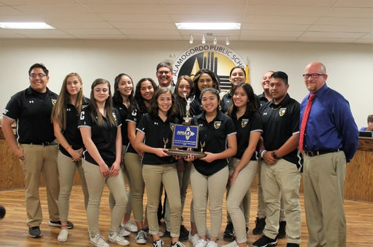 The Alamogordo High School Athletic Trainers with APS Superintendent Jerrett Perry, right and APS Board President Tim Wolfe back row, center.