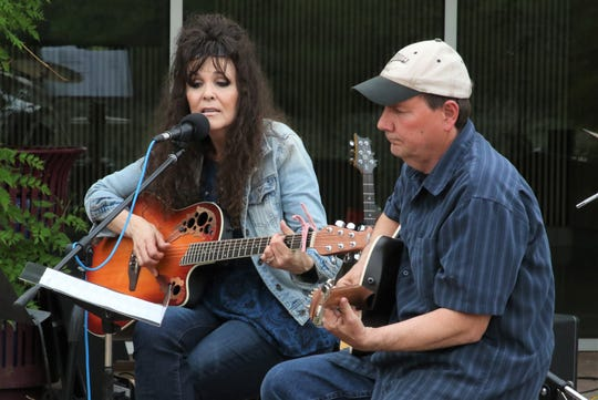 Lor and Russel Hodges are featured during the May 16 benefit concert for the family of Mauricio Espinal at the Farmington Museum at Gateway Park.