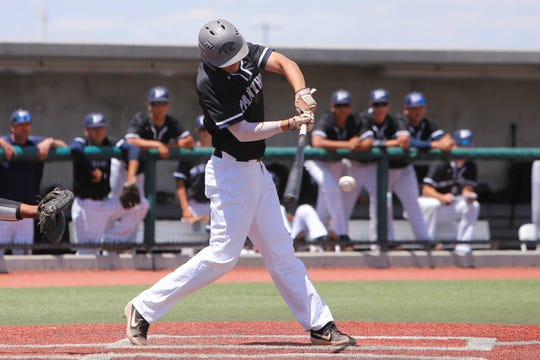 Piedra Vista's Matt Swarts hits an RBI single against Cleveland during Friday's 5A state baseball semifinals at Santa Ana Star Field in Albuquerque.