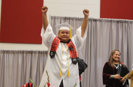 Lynman Lewis Pinto reacts to his name being called during spring commencement on May 17 for Navajo Technical University in Crownpoint.