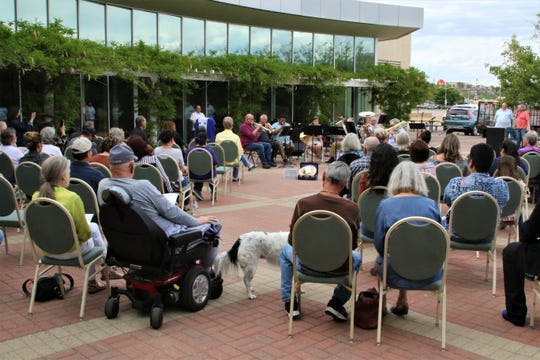 The group Celebration Brass performs on the patio of the Farmington Museum at Gateway Park on May 16 during a benefit concert for the family of Mauricio Espinal.