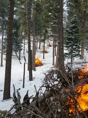 Forest slash piles are burned in the Lincoln National Forest during the winter to reduce the danger of wildfire once warmer weather and forest users return.