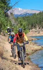 Mountain biking trails were created throughout the Smokey Bear Ranger District, including around Grindstone Lake.
