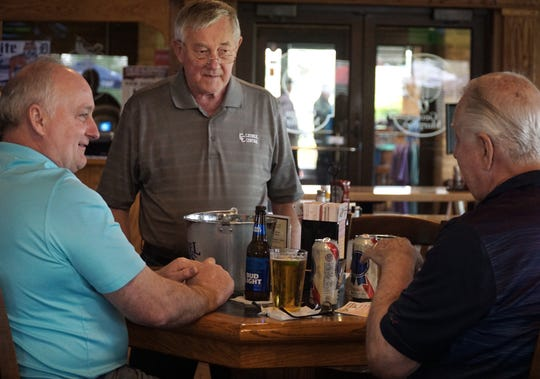 Mike Paluk, left, Joe Nemenes, and Norm Ponkey, right, chat over some brews at George Murphy's on May 17, 2019.