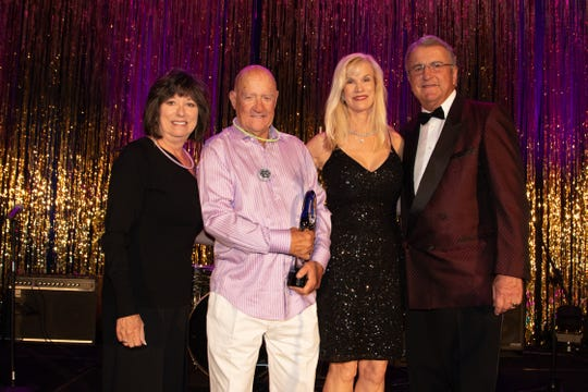 From left: Sheryl Benoit and Bill Powers, presenting the John J. Benoit Community Hero Award to Paula and Carl Karcher at the United Way Disco Ball  at the Westin Mission Hills Resort and Spa in Rancho Mirage on Friday, May 10, 2019.