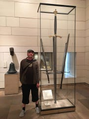 Hugh Newman appears at an exhibition of a 15th century giant sword found in Scotland.