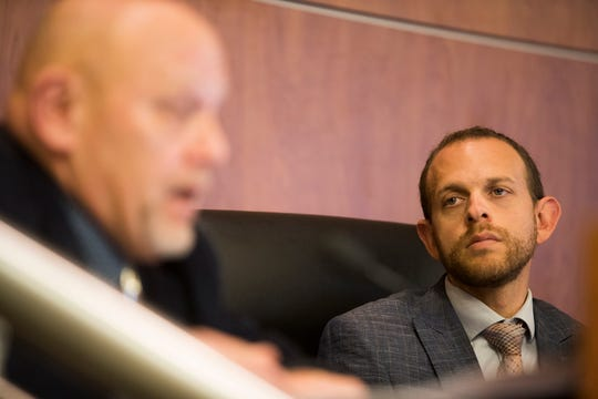 Aaron Hake, Second District Supervisor for Riverside County Planning Commission listens to Carl Shaffer, First District Supervisor during a meeting in May 2019.