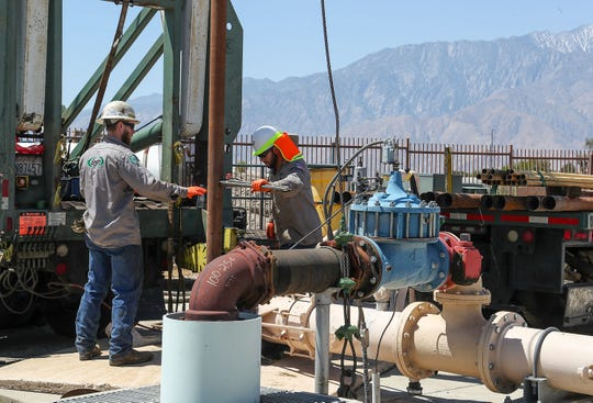 Stryder Pellicci, left, and Alejandro Olvera perform maintenence at Mission Springs Water District well site #24 near Little Morongo Rd. and Pierson St. in Desert Hot Springs, May 14, 2019.