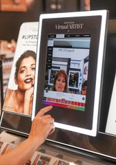 A customer uses a virtual artist screen to try on different makeup in the new Sephora which opened in downtown Palm Springs, May 17, 2019.