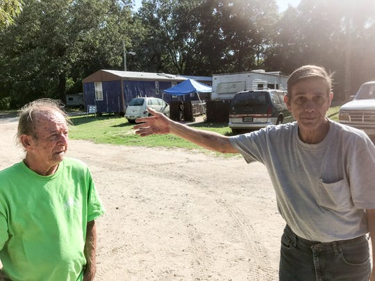 Willard Brigman, left, and John Wenzel were recently given a 30-day notice to relocate their mobile homes from Flamingo Park mobile home park on West Nine Mile Road. Like most residents of Flamingo Park, they live on a fixed-income and have nowhere else to go.