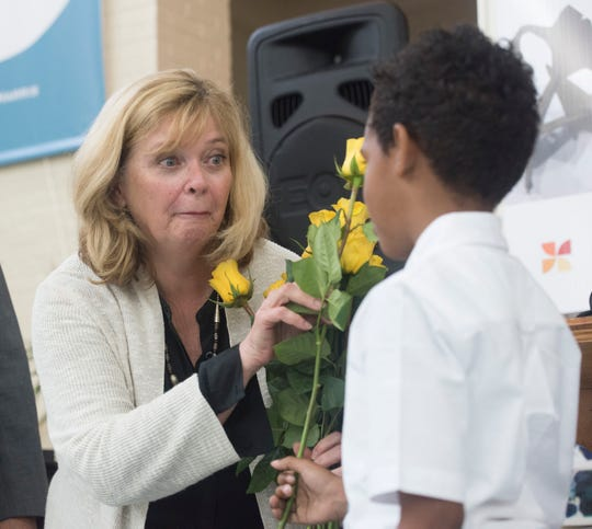 Innisfree Hotels founders Kim MacQueen receives a yellow rose as a thank-you from a student at Dixon School of Arts and Sciences on Friday, May 17, 2019. The MacQueens donated $1.25 million to the school during a ceremony at the school on Friday.