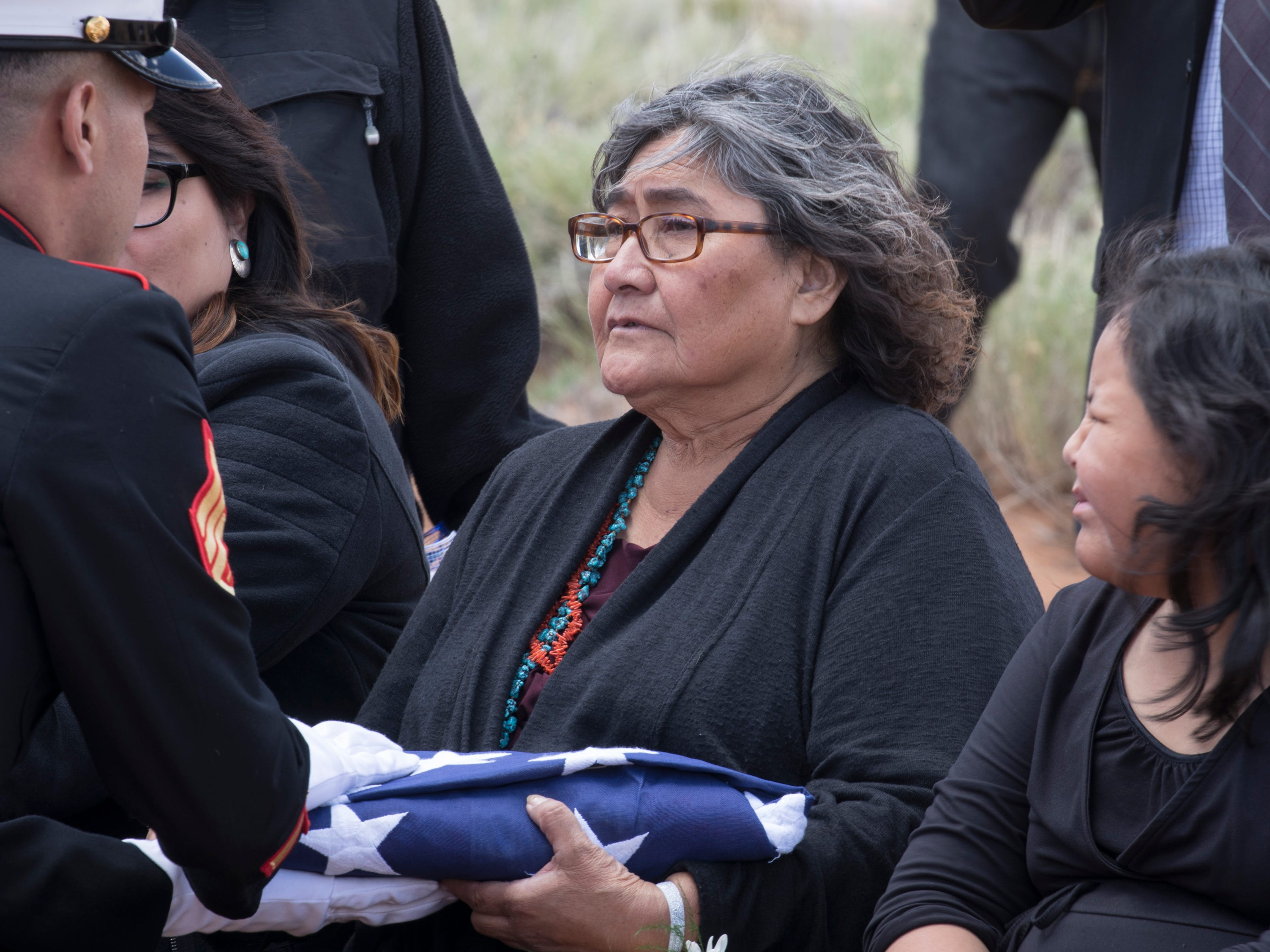 The flag was presented to Veronica Walter (daughter) during the interment of Navajo Code Talker Fleming Begaye Sr. on May 17, 2019, at the family plot in Salt Water Canyon, Ariz.