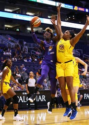 Phoenix Mercury guard Essence Carson drives on her former team Los Angeles during a preseason game. Carson signed with the Mercury as an unrestricted free agent in the offseason.