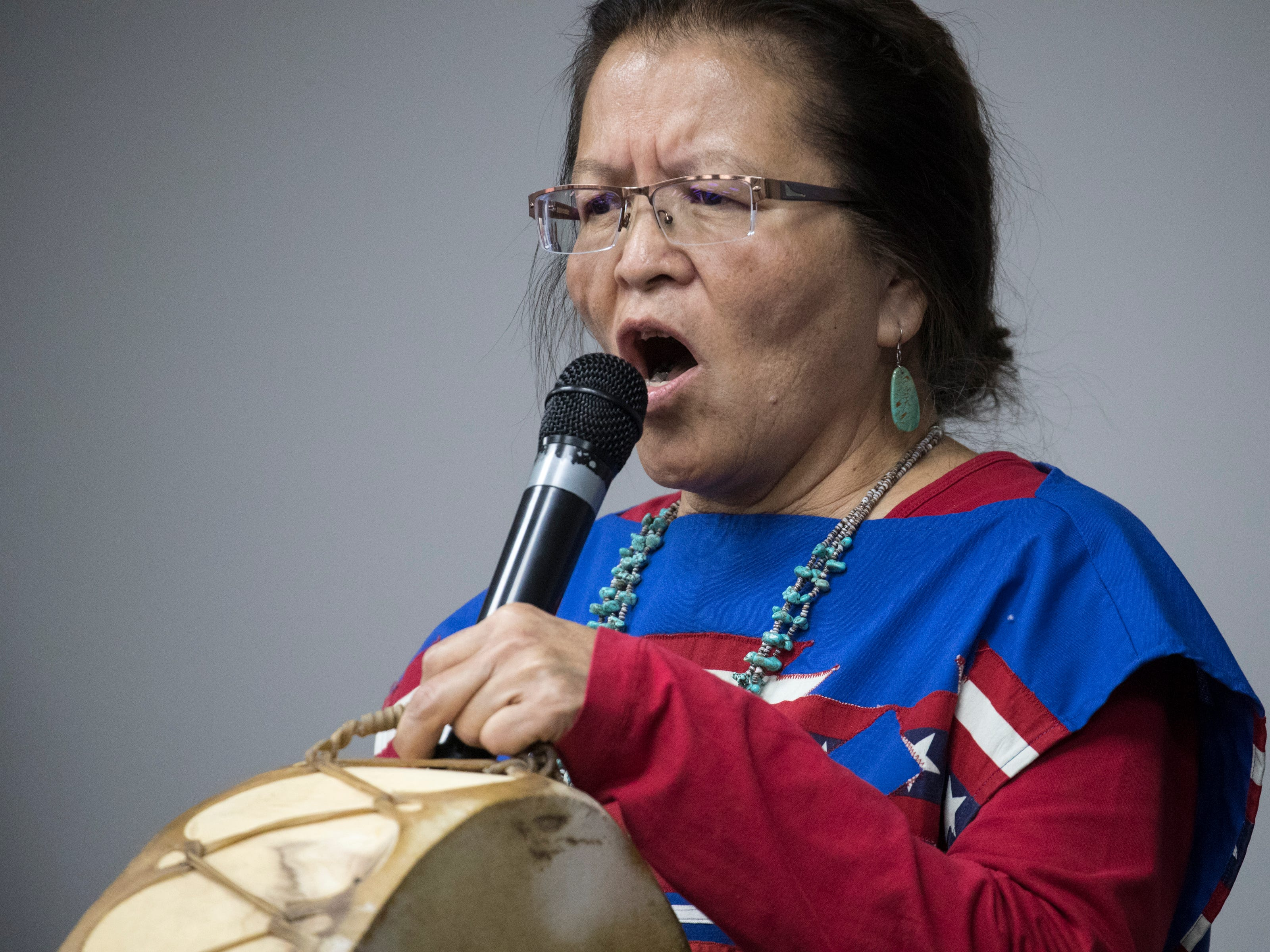 Julie Redhouse sings the National Anthem during the funeral service for Navajo Code Talker Fleming Begaye Sr. at the Potter's House Christian Center in Chinle, Ariz., on May 17, 2019.
