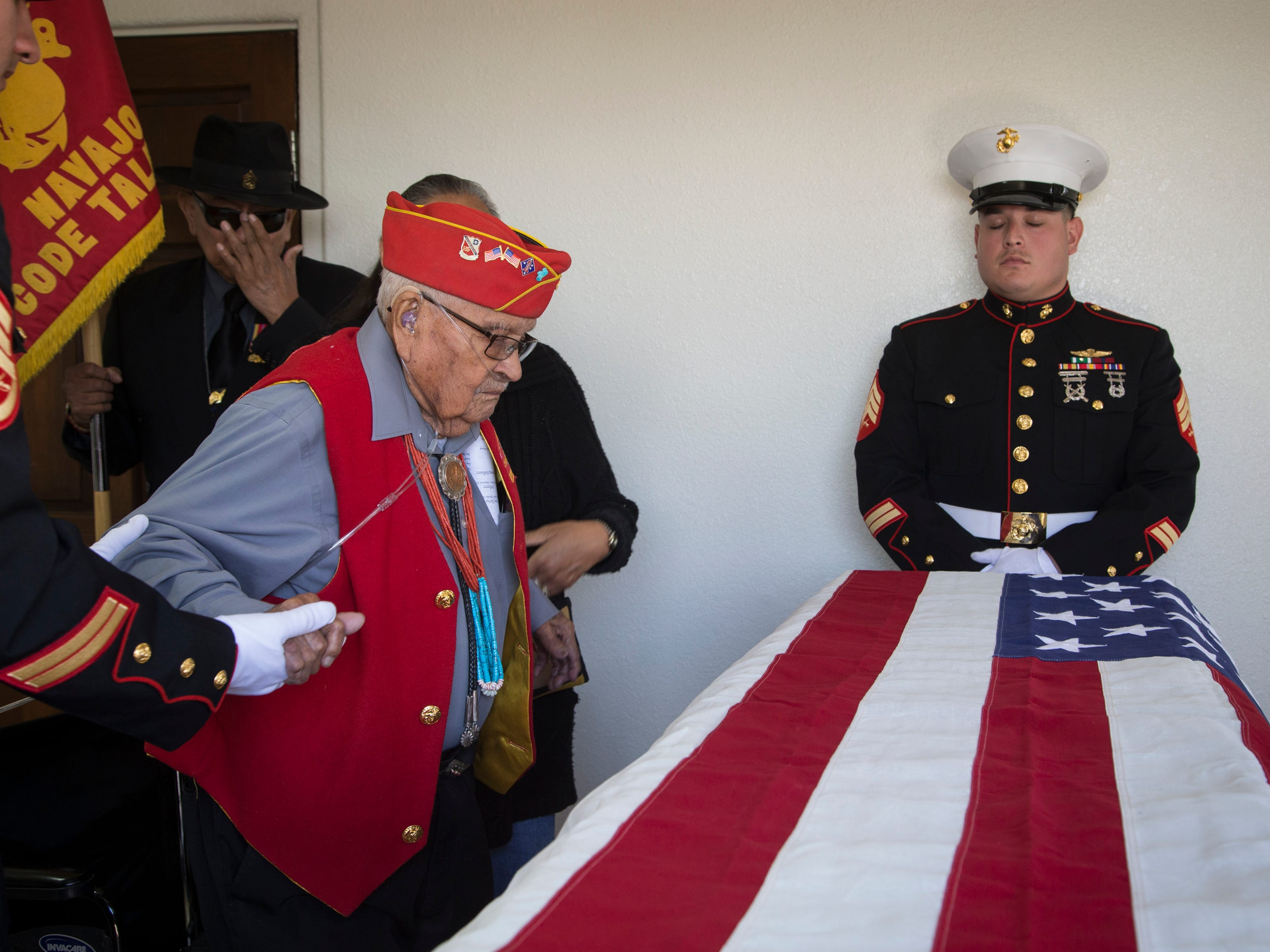 Navajo Code Talker Sam Sandoval (left) pays final respects to Navajo Code Talker Fleming Begaye Sr. on May 17, 2019, at the Potter's House Christian Center in Chinle, Ariz.
