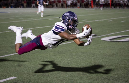 Wide receiver Jorden Young (16) of the Perry Pumas attempts a diving catch against the Pinnacle Pioneers at Pinnacle High School on Friday, August 17, 2018 in Phoenix, Arizona.