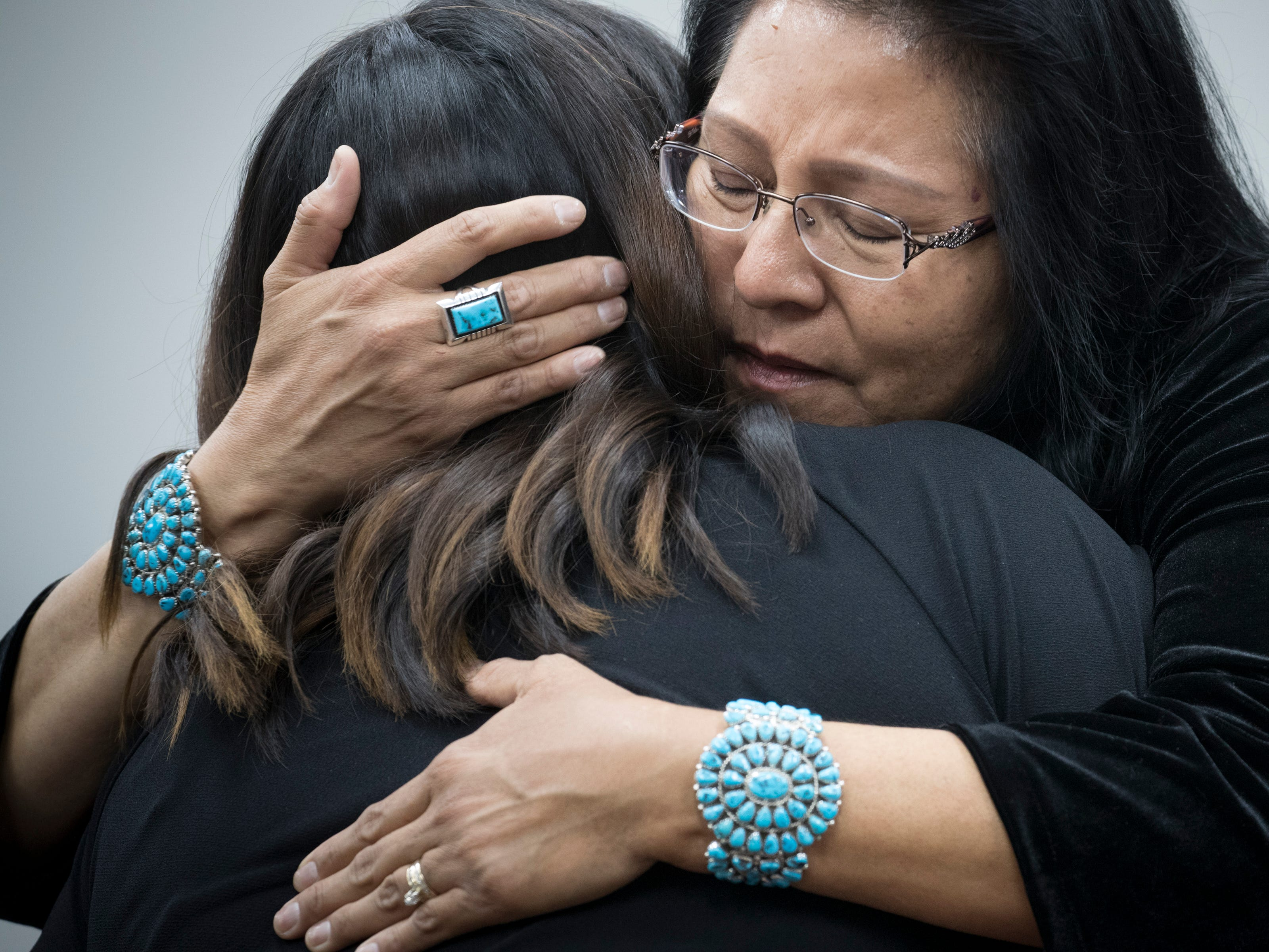 Dottie Lizer (right, Navajo Second Lady) hugs Theodosia Ott (granddaughter) during the funeral service for Navajo Code Talker Fleming Begaye Sr. May 17, 2019, at the Potter's House Christian Center in Chinle, Ariz.