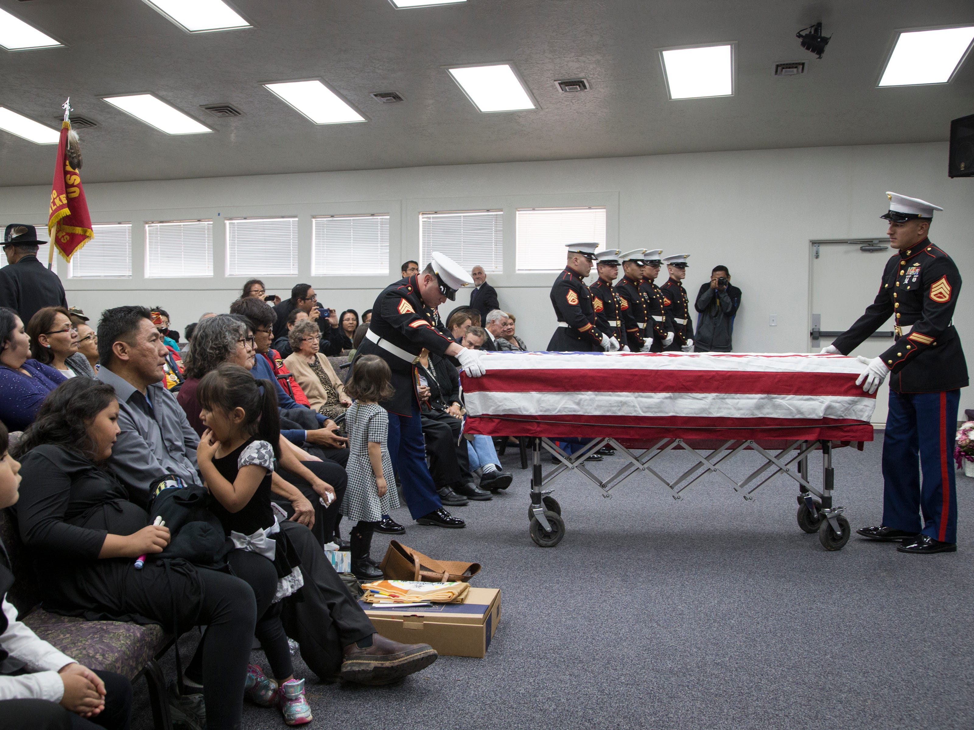 Pallbearers bring the casket of Navajo Code Talker Fleming Begaye's Sr. out of the Potter's House Christian Center on May 17, 2019, in Chinle, Ariz.