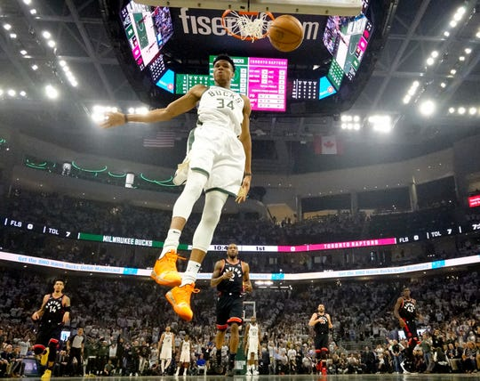 Milwaukee Bucks' Giannis Antetokounmpo dunks during the first half of Game 1 of the NBA Eastern Conference basketball playoff finals against the Toronto Raptors Wednesday, May 15, 2019, in Milwaukee. (AP Photo/Morry Gash)