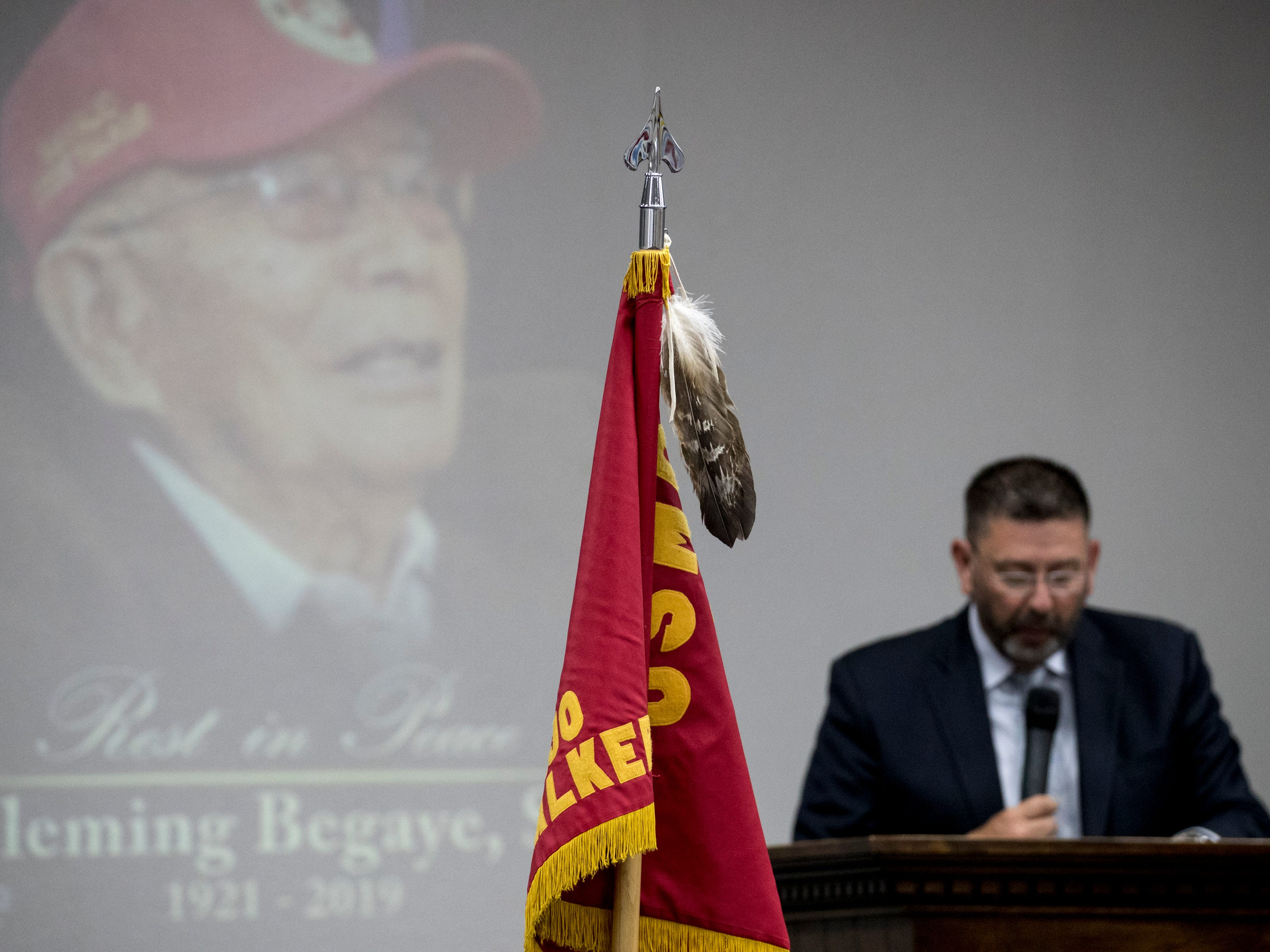 Jim Yates speaks during the funeral service for Navajo Code Talker Fleming Begaye Sr. at the Potter's House Christian Center in Chinle, Ariz., on May 17, 2019.