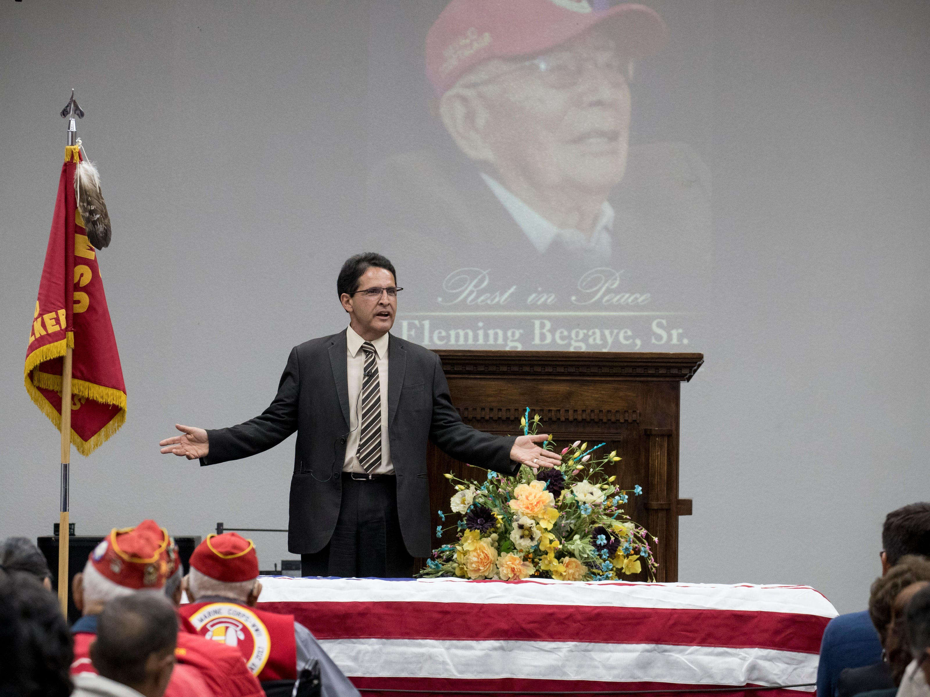 Pastor Artie Aragon speaks during the funeral service for Navajo Code Talker Fleming Begaye Sr. on May 17, 2019, at the Potter's House Christian Center in Chinle, Ariz.