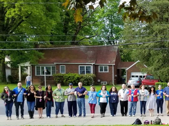Poughkeepsie Middle School teachers protest outside their building on Friday morning.