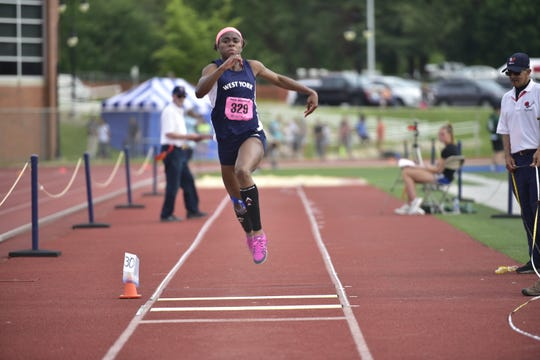 West York's Tesia Thomas leaps her way to a first place finish in the girls 3A triple jump at the District 3 track and field championships at Shippensburg University on May 17, 2019.