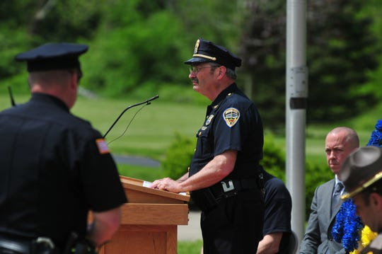 Chief Jim Branum reads names of fallen officers during the annual Peace Officers Memorial Service.
