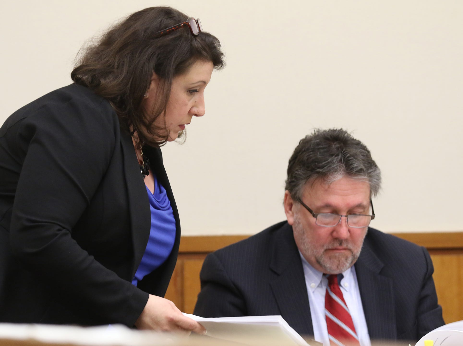 Assistant District Attorney Gina Clark shows medical records of Christopher Pate to Clark Zimmermann, Rochester police officer Michael Sippel's lawyer.