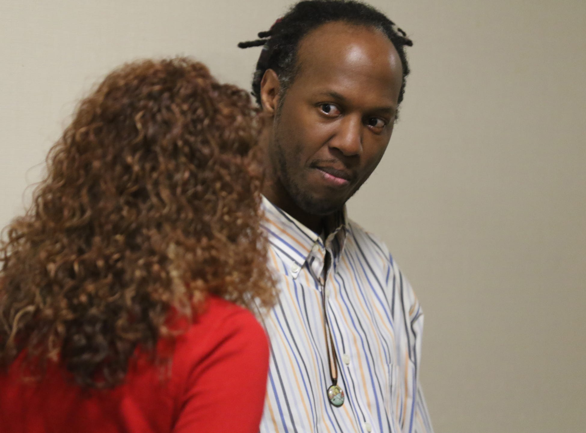 Christopher Pate waits outside the courtroom to be called in.