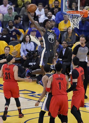 Golden State Warriors forward Jordan Bell (2) dunks against the Portland Trail Blazers during the first half of Game 2 of the NBA basketball playoffs Western Conference finals in Oakland, Calif., Thursday, May 16, 2019.