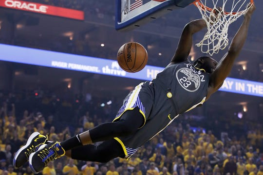 Golden State Warriors forward Draymond Green dunks against the Portland Trail Blazers during the first half of Game 2 of the NBA basketball playoffs Western Conference finals in Oakland, Calif., Thursday, May 16, 2019.