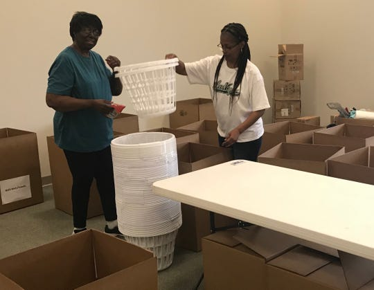 Marjorie Green, left, and Detra Harris arrived early to the United Way of the Concho Valley's Day of Caring event to size up the scope of work for the day.