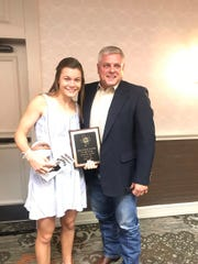 Wall High School's Sawyer Lloyd, with her stepfather Kevin Barron, was presented with her TABC Girls Class 3A Player of the Year award Thursday, May 16, in San Antonio.