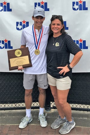 Brady High School's Jack Marshall and Bulldog tennis coach Tina Kendall show off the medal and plaque Marshall was awarded in defending his boys singles title at the Class 3A UIL State Tennis Championship Friday, May 17, 2019, in College Station.