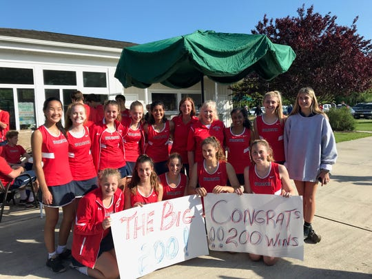 The 2019 Worcester Prep girls tennis teams celebrates coaches Cyndee Hudson and Debbie Speier on their 200th career win.