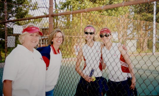 Worcester Prep tennis coaches Cyndee Hudson and Debbie Speier stand with two players at the Worcester Prep tennis courts.