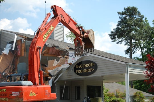 A view of demolition of the clubhouse's front entrance.