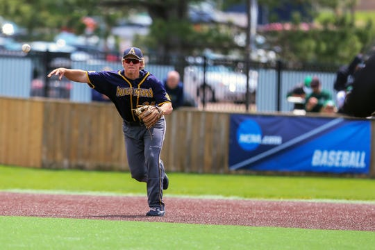 """Augustana University""""s Third Basemen #35 throws to first base after fielding a ground ball during AU's Central Regional game Friday at Karras Park, home of Ronken Field.  The Viking won 9-4 and advance to Saturday's championship game at Noon."""