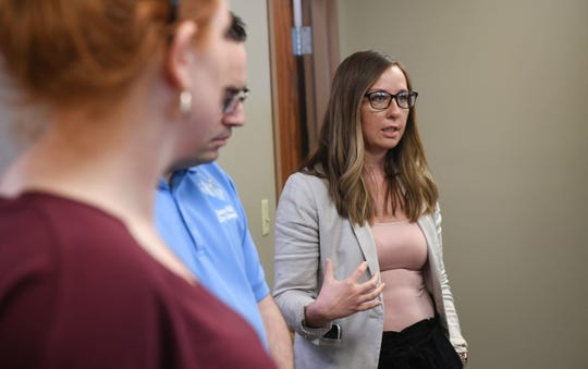 Erin Srstka, Minnehaha County Commission program development officer, explains next steps for a triage clinic Thursday, May 16, in downtown Sioux Falls.