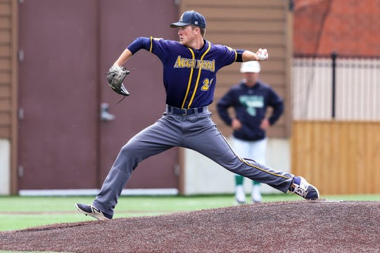 Augustana University Pitcher #20 Tanner Brown throws home during AU's Central Regional game Friday at Karras Park, home of Ronken Field.  The Viking won 9-4 and advance to Saturday's championship game at Noon.