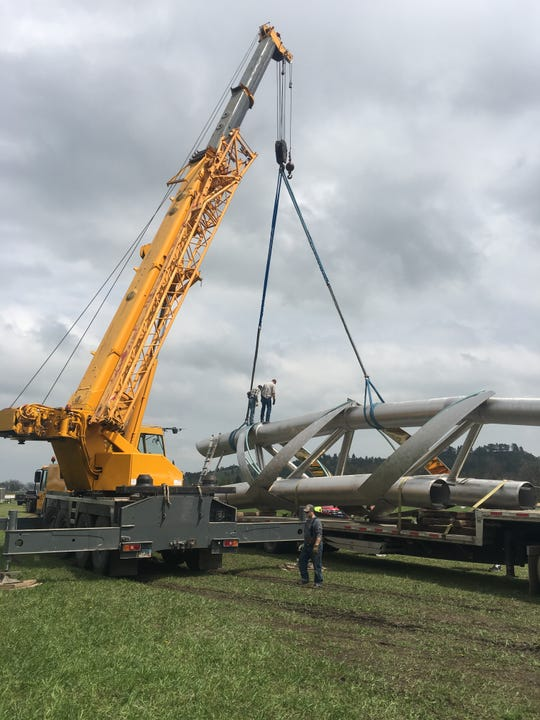 A moving crew spent this week loading segments of the Arc of Dreams onto trailers before hauling the massive sculpture to Sioux Falls Friday.