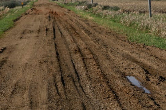 Gravel and dirt roads, including this one in Lincoln County, are critical transportation routes for agricultural producers and residents of rural areas in southeastern South Dakota. Recent flooding has left many either washed out or impassable due to soft, rutted conditions..
