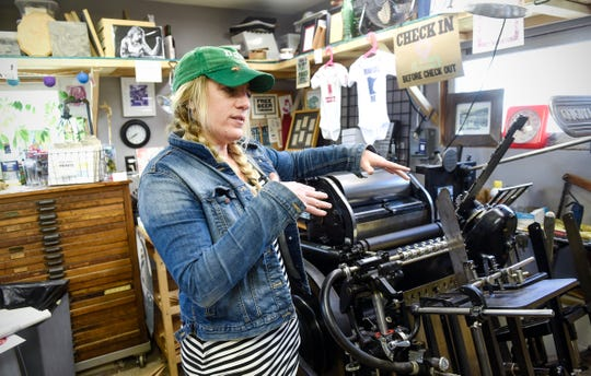 Mary Bruno says a proposed, state-run paid leave program would be a game changer for small businesses like hers, Bruno Press, shown here on Friday, May 17, in St. Joseph.