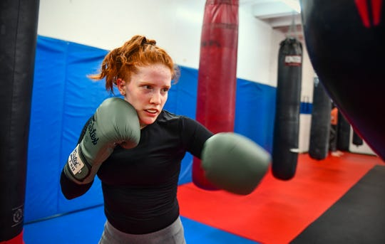 Annabel Kelly concentrates on the punching bag while training Wednesday, May 15, at the St. Cloud Boxing & Wrestling Club in St. Cloud. Kelly, a senior at Sauk Rapids-Rice High School, is a mixed martial arts athlete.