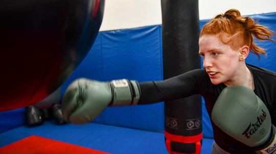 Annabel Kelly concentrates on the punching bag while training Wednesday, May 15, at the St. Cloud Boxing & Wrestling Club in St. Cloud.
